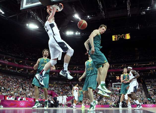 LONDON, ENGLAND - AUGUST 08:  Kevin Love #11 of United States dunks the ball in the first half while taking on Australia during the Men's Basketball quaterfinal game on Day 12 of the London 2012 Olympic Games at North Greenwich Arena on August 8, 2012 in London, England. Photo: Christian Petersen, Getty Images / 2012 Getty Images