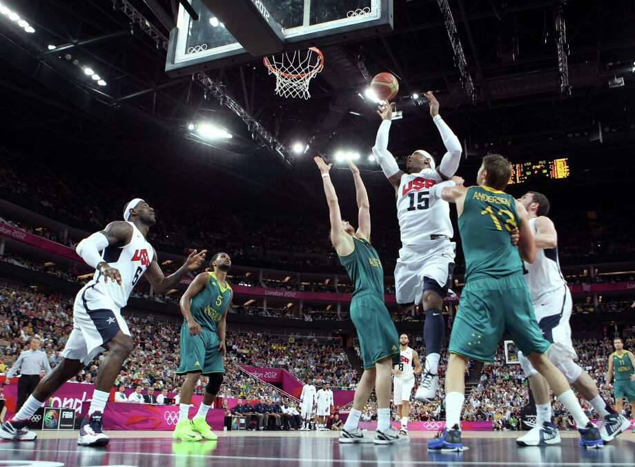 LONDON, ENGLAND - AUGUST 08:  Carmelo Anthony #15 of United States goes up for a shot against David Andersen #13 of Australia in the first half during the Men's Basketball quaterfinal game on Day 12 of the London 2012 Olympic Games at North Greenwich Arena on August 8, 2012 in London, England. Photo: Christian Petersen, Getty Images / 2012 Getty Images