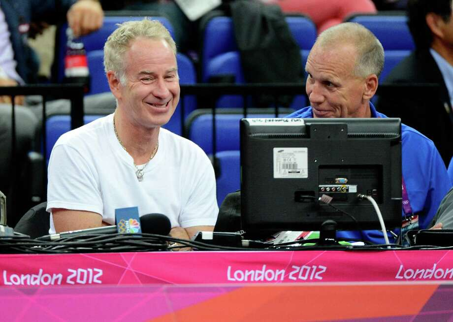 LONDON, ENGLAND - AUGUST 08:  Former professional tennis player John McEnroe sits courtside with Philadelphia 76ers head coach Doug Collins before the United States takes on Australia in the Men's Basketball quaterfinal game on Day 12 of the London 2012 Olympic Games at North Greenwich Arena on August 8, 2012 in London, England. Photo: Ronald Martinez, Getty Images / 2012 Getty Images