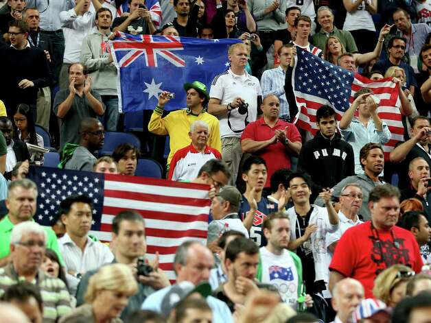 LONDON, ENGLAND - AUGUST 08:  United States and Australia fans hold up flags in the first half during the Men's Basketball quaterfinal game on Day 12 of the London 2012 Olympic Games at North Greenwich Arena on August 8, 2012 in London, England. Photo: Christian Petersen, Getty Images / 2012 Getty Images