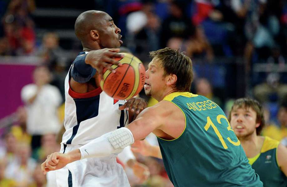 LONDON, ENGLAND - AUGUST 08:  Kobe Bryant #10 of United States passes the ball around the head of David Andersen #13 of Australia in the first half during the Men's Basketball quaterfinal game on Day 12 of the London 2012 Olympic Games at North Greenwich Arena on August 8, 2012 in London, England. Photo: Ronald Martinez, Getty Images / 2012 Getty Images