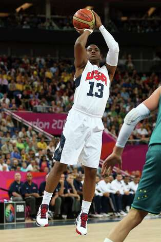 LONDON, ENGLAND - AUGUST 08:  Chris Paul #13 of United States shoots a jumper in the first half while taking on Australia during the Men's Basketball quaterfinal game on Day 12 of the London 2012 Olympic Games at North Greenwich Arena on August 8, 2012 in London, England. Photo: Christian Petersen, Getty Images / 2012 Getty Images