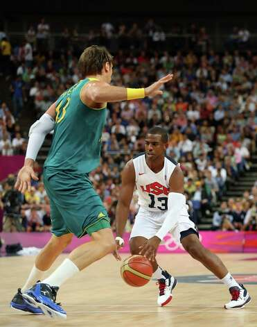 LONDON, ENGLAND - AUGUST 08:  Chris Paul #13 of United States moves the ball against David Andersen #13 of Australia in the first half during the Men's Basketball quaterfinal game on Day 12 of the London 2012 Olympic Games at North Greenwich Arena on August 8, 2012 in London, England. Photo: Christian Petersen, Getty Images / 2012 Getty Images