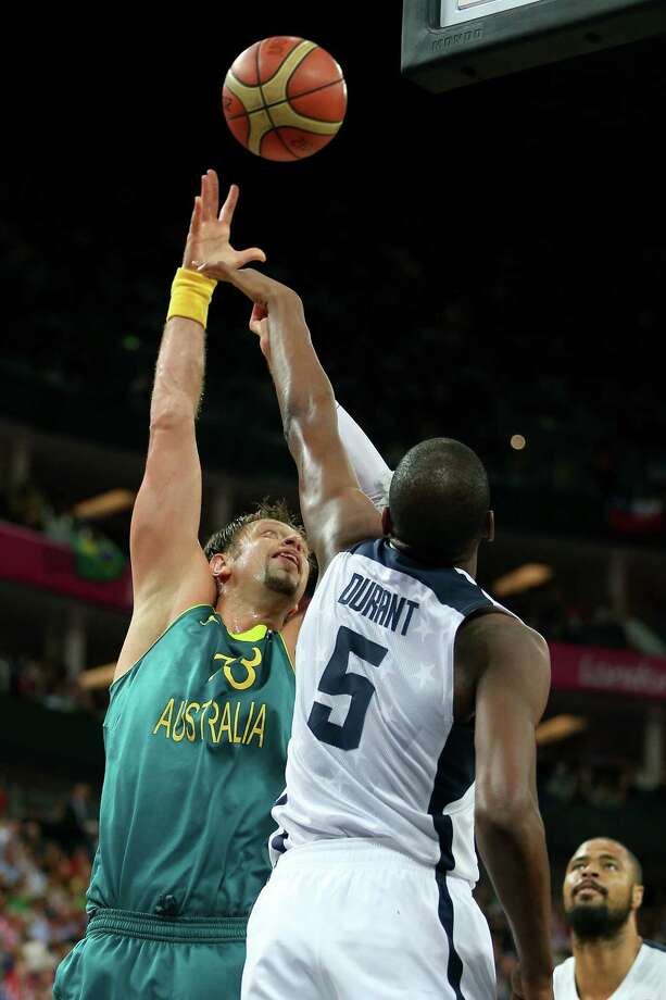 LONDON, ENGLAND - AUGUST 08:  David Andersen #13 of Australia shoots over Kevin Durant #5 of United States in the third quarter during the Men's Basketball quaterfinal game on Day 12 of the London 2012 Olympic Games at North Greenwich Arena on August 8, 2012 in London, England. Photo: Christian Petersen, Getty Images / 2012 Getty Images
