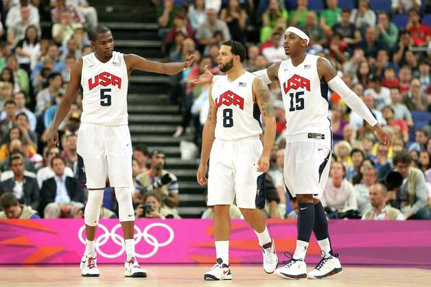 LONDON, ENGLAND - AUGUST 08:  Kevin Durant #5, Deron Williams #8 and Carmelo Anthony #15 of United States celebrate a play in the second half while taking on Australia during the Men's Basketball quaterfinal game on Day 12 of the London 2012 Olympic Games at North Greenwich Arena on August 8, 2012 in London, England. Photo: Christian Petersen, Getty Images / 2012 Getty Images