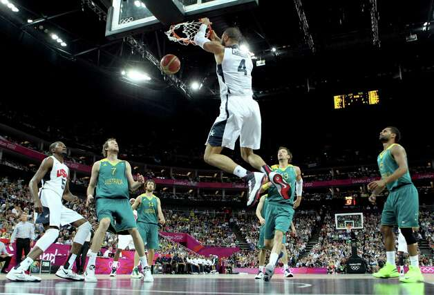 LONDON, ENGLAND - AUGUST 08:  Tyson Chandler #4 of United States dunks the ball in the first quarter against Australia during the Men's Basketball quaterfinal game on Day 12 of the London 2012 Olympic Games at North Greenwich Arena on August 8, 2012 in London, England. Photo: Christian Petersen, Getty Images / 2012 Getty Images
