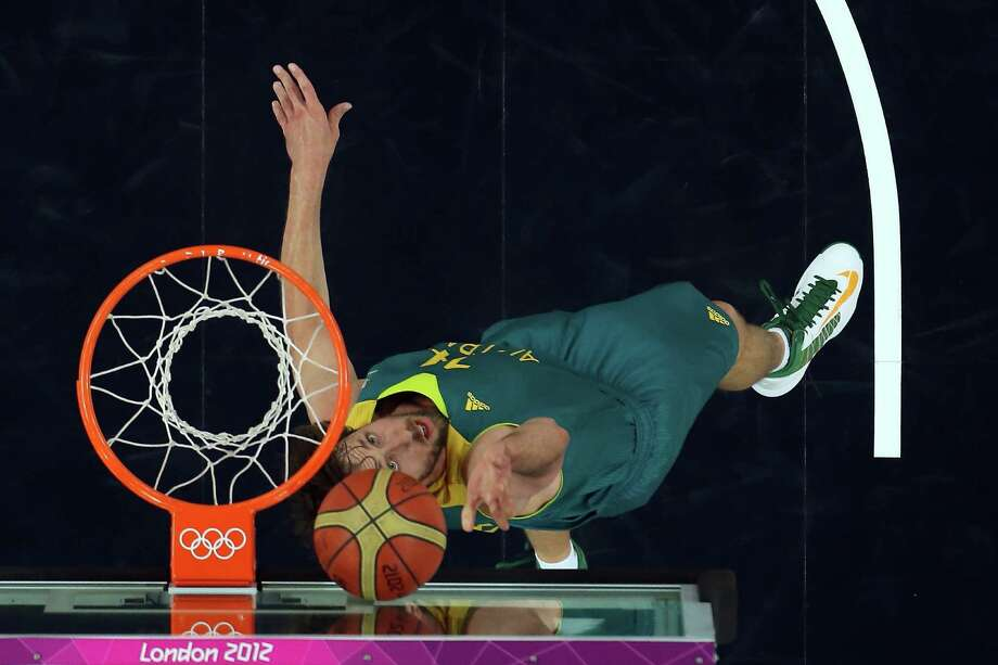 LONDON, ENGLAND - AUGUST 08:  Matt Nielsen #14 of Australia lays the ball up in the first half against the United States during the Men's Basketball quaterfinal game on Day 12 of the London 2012 Olympic Games at North Greenwich Arena on August 8, 2012 in London, England. Photo: Ronald Martinez, Getty Images / 2012 Getty Images