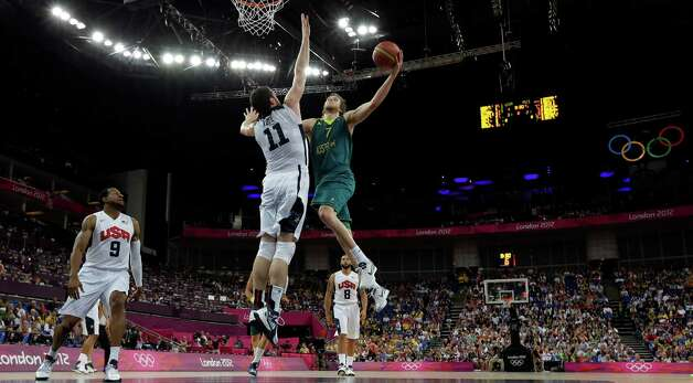 Australia's Joe Ingles (7) drives to the basket against USA's Kevin Love (11) during a quarterfinal men's basketball game at the 2012 Summer Olympics, Wednesday, Aug. 8, 2012, in London. (AP Photo/Eric Gay) Photo: Eric Gay, Associated Press / AP