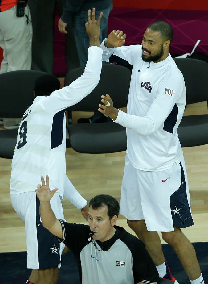 United States' Tyson Chandler, right, celebrates with teammate Andre Iguodala, left, after a three point basket by United States' Kobe Bryant during a quarterfinal men's basketball game against Australia at the 2012 Summer Olympics, Wednesday, Aug. 8, 2012, in London. (AP Photo/Victor R. Caivano) Photo: Victor R. Caivano, Associated Press / AP