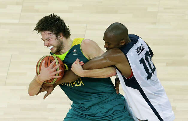 United States' Kobe Bryant, right, and Australia's Matt Dellavedova, left, scramble for the ball during a quarterfinal men's basketball game at the 2012 Summer Olympics, Wednesday, Aug. 8, 2012, in London. (AP Photo/Victor R. Caivano) Photo: Victor R. Caivano, Associated Press / AP