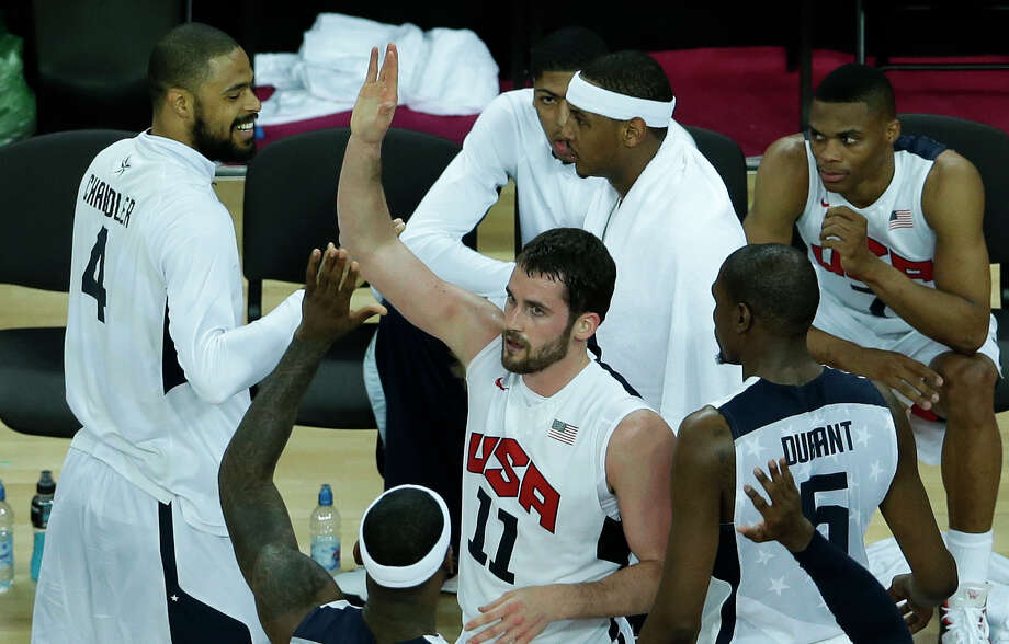 United States' Kevin Love (11) is congratulated by teammates after a play during a quarterfinal men's basketball game against Australia at the 2012 Summer Olympics, Wednesday, Aug. 8, 2012, in London. (AP Photo/Victor R. Caivano) Photo: Victor R. Caivano, Associated Press / AP