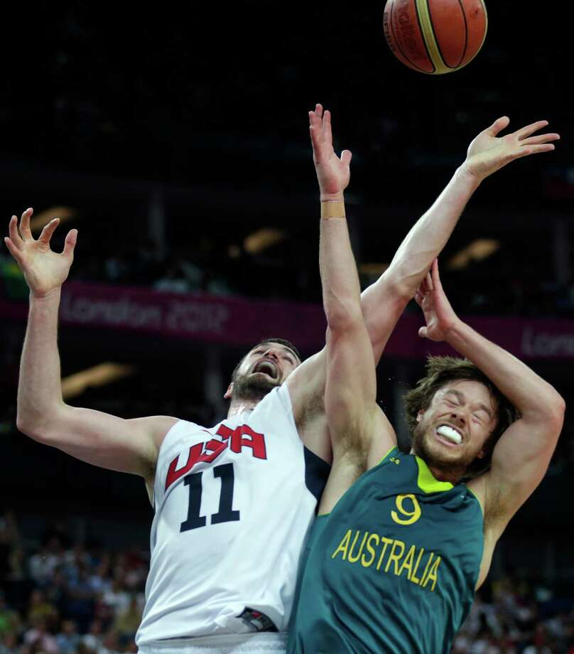 USA's Kevin Love, left, battles Australia's Matt Dellavedova for a rebound during a men's quarterfinals basketball game at the 2012 Summer Olympics, Wednesday, Aug. 8, 2012, in London. (AP Photo/Charles Krupa) Photo: Charles Krupa, Associated Press / AP
