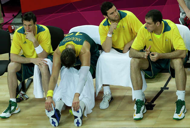 Australia's players sit on the bench during the final moments of their quarterfinal men's basketball game against United States at the 2012 Summer Olympics, Wednesday, Aug. 8, 2012, in London. (AP Photo/Victor R. Caivano) Photo: Victor R. Caivano, Associated Press / AP