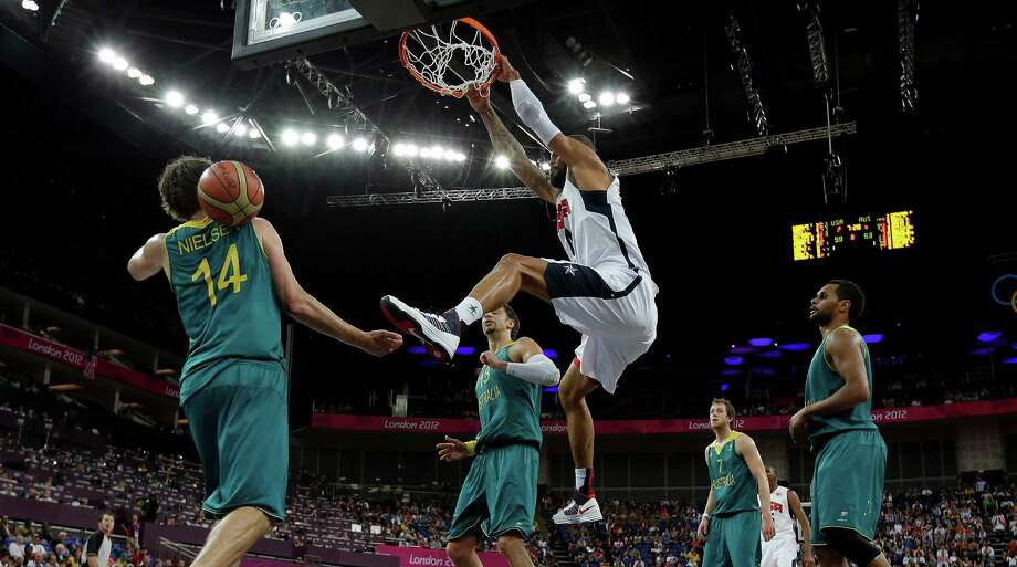 USA's Tyson Chandler, center, slam dunks against Australia during a quarterfinal men's basketball game at the 2012 Summer Olympics, Wednesday, Aug. 8, 2012, in London. (AP Photo/Eric Gay) Photo: Eric Gay, Associated Press / AP