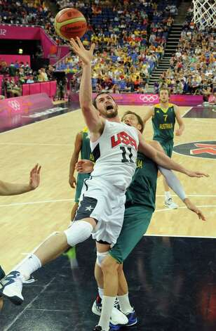 United States' forward Kevin Love, left, jumps for the ball during a men's quarterfinal basketball game against Australia at the 2012 Summer Olympics on Wednesday, Aug. 8, 2012, in London. (AP Photo/Mark Ralston, Pool) Photo: Mark Ralston, Associated Press / Pool AFP