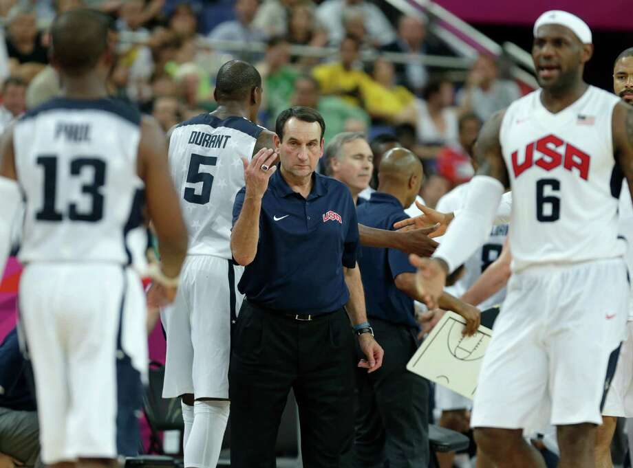 USA's head coach Mike Krzyzewski, center calls over Chris Paul during a men's quarterfinals basketball game against Australia at the 2012 Summer Olympics, Wednesday, Aug. 8, 2012, in London. (AP Photo/Charles Krupa) Photo: Charles Krupa, Associated Press / AP