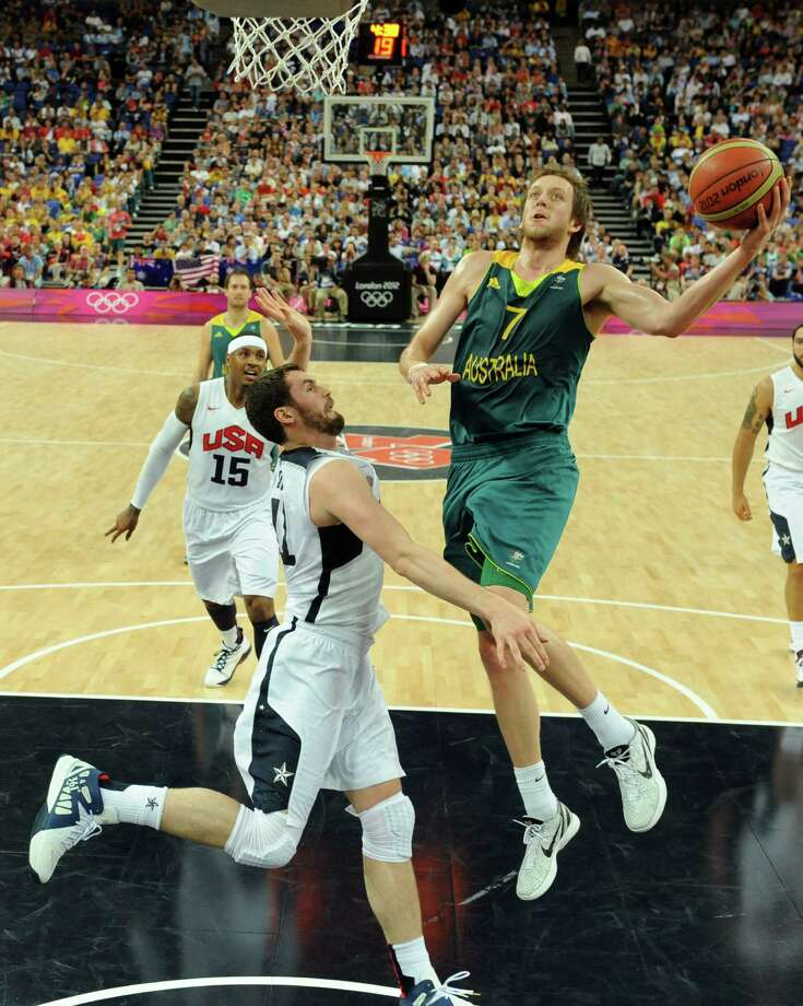 Australia's forward Joe Ingles, right, is challenged by United States' forward Kevin Love during their men's quarterfinal basketball game at the 2012 Summer Olympics on Wednesday, Aug. 8, 2012, in London. (AP Photo/Mark Ralston, Pool) Photo: Mark Ralston, Associated Press / Pool AFP