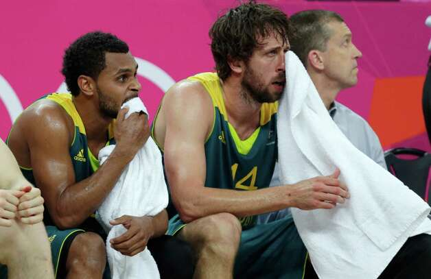 Australia's Patrick Mills, left, and Matt Nielsen sit on the bench during the final minutes of a game against the United States during a men's quarterfinals basketball game at the 2012 Summer Olympics, Thursday, Aug. 9, 2012, in London. (AP Photo/Charles Krupa) Photo: Charles Krupa, Associated Press / AP