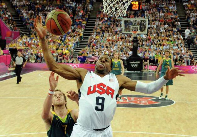 United States' forward Andre Iguodala, front, is challenged by Australia's forward Joe Ingles during their men's quarterfinal basketball game at the 2012 Summer Olympics on Wednesday, Aug. 8, 2012, in London. (AP Photo/Mark Ralston, Pool) Photo: Mark Ralston, Associated Press / Pool AFP
