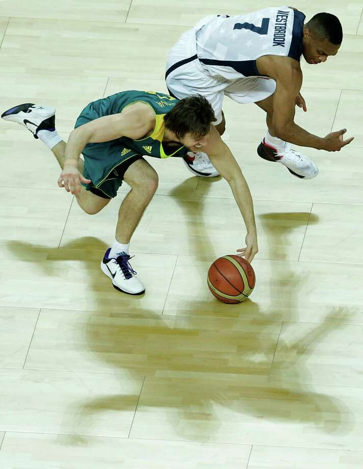 Australia's Matt Dellavedova, left, and United States' Russell Westbrook, right, go for a loose ball during a quarterfinal men's basketball game at the 2012 Summer Olympics, Wednesday, Aug. 8, 2012, in London. (AP Photo/Victor R. Caivano) Photo: Victor R. Caivano, Associated Press / AP