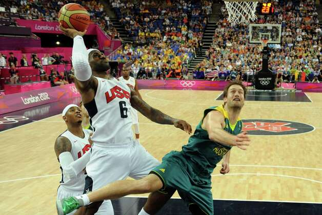 Unites States forward LeBron James, left, jumps to score during during a men's quarterfinal basketball game against Australia at the 2012 Summer Olympics on Wednesday, Aug. 8, 2012, in London. (AP Photo/Mark Ralston, Pool) Photo: Mark Ralston, Associated Press / Pool AFP