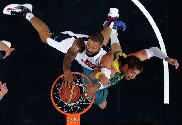USA's Tyson Chandler slams a dunk against  Australia's David Andersen during a men's quarterfinals basketball game at the 2012 Summer Olympics, Wednesday, Aug. 8, 2012, in London. (AP Photo/Charles Krupa) Photo: Charles Krupa, Associated Press / AP
