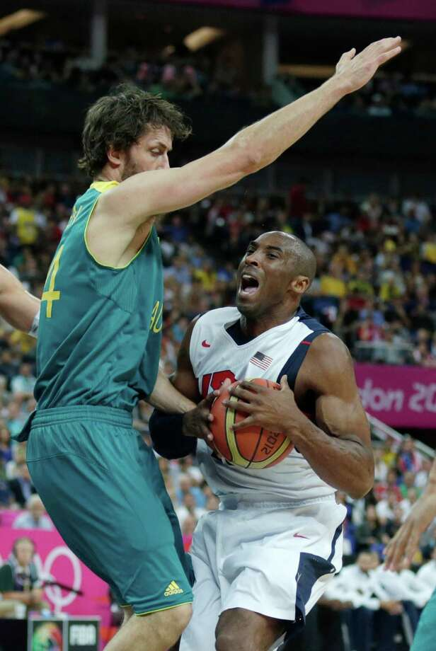 Australia's Matt Nielsen, left, covers USA's Kobe Bryant on a drive to the basket during a men's quarterfinals basketball game at the 2012 Summer Olympics, Wednesday, Aug. 8, 2012, in London. (AP Photo/Charles Krupa) Photo: Charles Krupa, Associated Press / AP