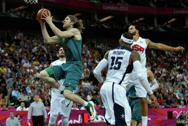 Australia's David Barlow drives past USA's Carmelo Anthony (15) during a men's quarterfinals basketball game at the 2012 Summer Olympics, Wednesday, Aug. 8, 2012, in London. (AP Photo/Charles Krupa) Photo: Charles Krupa, Associated Press / AP