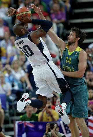 USA's Kobe Bryant (10) is defended by Australia's Matt Nielsen (14) during a quarterfinal men's basketball game at the 2012 Summer Olympics, Wednesday, Aug. 8, 2012, in London. (AP Photo/Eric Gay) Photo: Eric Gay, Associated Press / AP