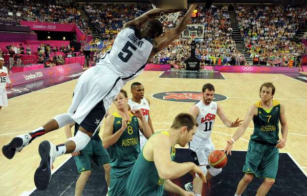 United States' forward Kevin Durant, left, slams a dunk during a men's quarterfinal basketball game against Australia at the 2012 Summer Olympics on Wednesday, Aug. 8, 2012, in London. (AP Photo/Mark Ralston, Pool) Photo: Mark Ralston, Associated Press / Pool AFP