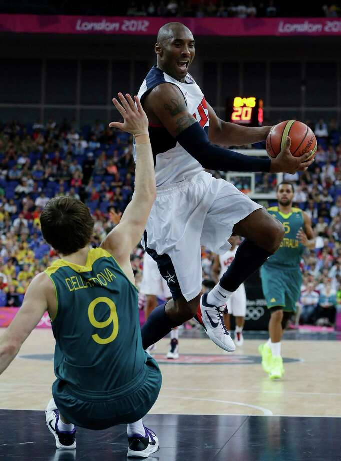 USA's Kobe Bryant, right, runs into Australia's Matt Dellavedova (9) during a quarterfinal men's basketball game at the 2012 Summer Olympics, Wednesday, Aug. 8, 2012, in London. (AP Photo/Eric Gay) Photo: Eric Gay, Associated Press / AP