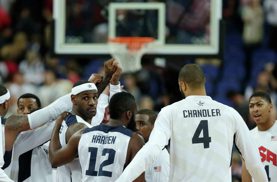 USA's LeBron James, with head band, gathers with teammates after beating Australia during a men's quarterfinals basketball game at the 2012 Summer Olympics, Thursday, Aug. 9, 2012, in London. (AP Photo/Charles Krupa) Photo: Charles Krupa, Associated Press / AP