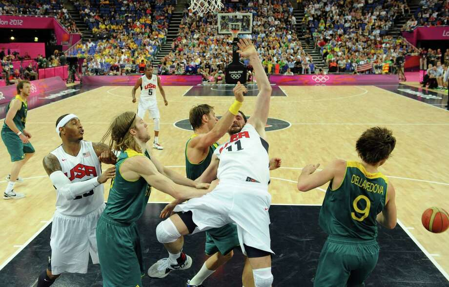 United States' forward Kevin Love falls to the ground during a men's quarterfinal basketball game against Australia at the 2012 Summer Olympics on Wednesday, Aug. 8, 2012, in London. (AP Photo/Mark Ralston, Pool) Photo: Mark Ralston, Associated Press / Pool AFP