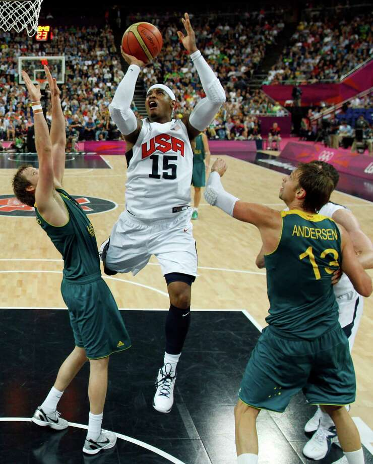 Carmelo Anthony, center, of the United States shoot against Australia during a men's quarterfinal basketball game at the 2012 Summer Olympics on Wednesday, Aug. 8, 2012, in London. (AP Photo/Sergio Perez, Pool) Photo: Sergio Perez, Associated Press / Pool Reuters