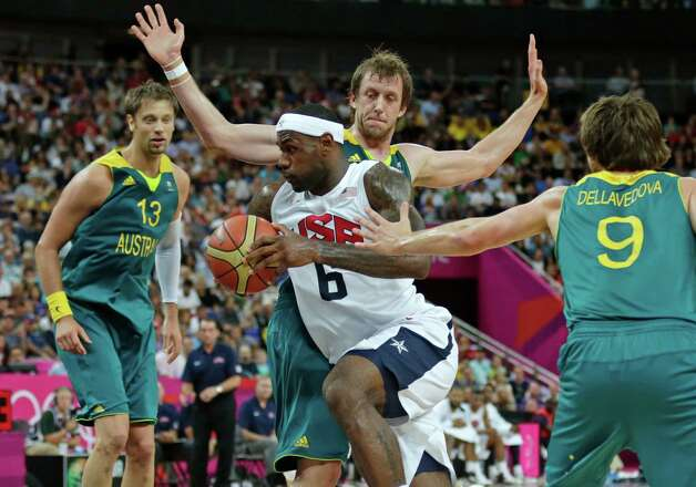 USA's LeBron James (6) drives to the basket against Australia during a men's quarterfinals basketball game at the 2012 Summer Olympics, Wednesday, Aug. 8, 2012, in London.  From left are Australia's David Andersen, Matt Nielsen and Matt Dellavedova. (AP Photo/Charles Krupa) Photo: Charles Krupa, Associated Press / AP