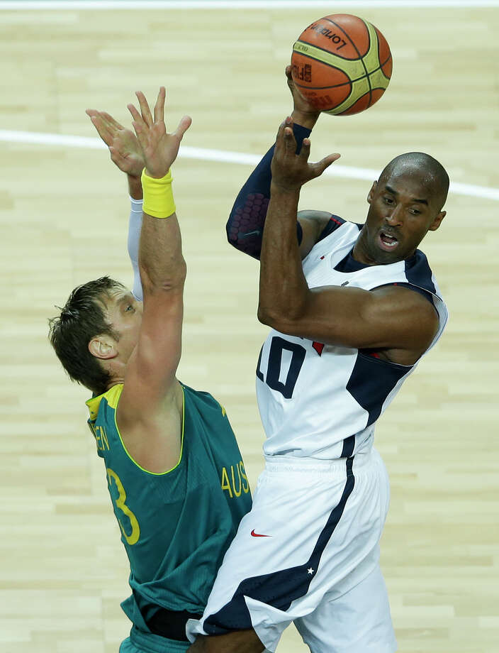 USA's Kobe Bryant, right, is defended by Australia's David Andersen, left, during a quarterfinal men's basketball game at the 2012 Summer Olympics, Wednesday, Aug. 8, 2012, in London. (AP Photo/Victor R. Caivano) Photo: Victor R. Caivano, Associated Press / AP