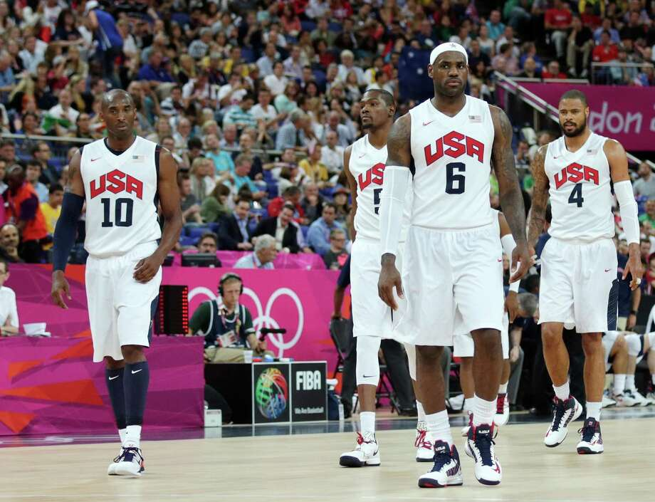 USA's Lebron James (6) walks up the court with teammates Kobe Bryant (10), Kevin Durant (5) and Tyson Chandler (4) during a men's quarterfinals basketball game against Australia at the 2012 Summer Olympics, Wednesday, Aug. 8, 2012, in London. (AP Photo/Charles Krupa) Photo: Charles Krupa, Associated Press / AP