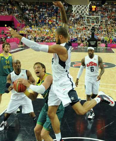 United States' center Tyson Chandler challenges Australia's forward David Andersen during a men's quarterfinal basketball game at the 2012 Summer Olympics on Wednesday, Aug. 8, 2012, in London. (AP Photo/Mark Ralston, Pool) Photo: Mark Ralston, Associated Press / Pool AFP