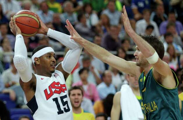 USA's Carmelo Anthony, left, is covered by Australia's Mark Worthington during a men's quarterfinals basketball game at the 2012 Summer Olympics, Wednesday, Aug. 8, 2012, in London. (AP Photo/Charles Krupa) Photo: Charles Krupa, Associated Press / AP