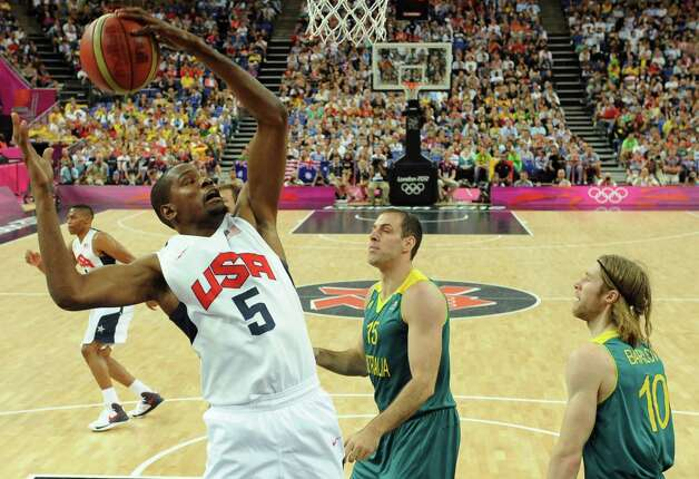 United States' forward Kevin Durant jumps for the ball during his team's men's quarterfinal basketball game against Australia at the 2012 Summer Olympics on Wednesday, Aug. 8, 2012, in London. (AP Photo/Mark Ralston, Pool) Photo: Mark Ralston, Associated Press / Pool AFP