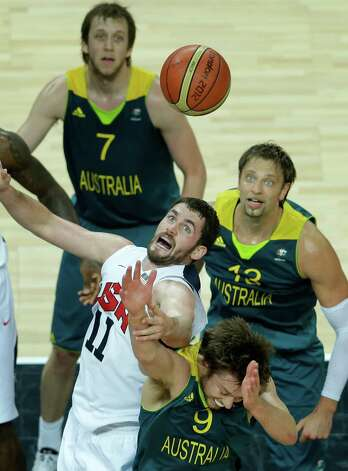 United States' Kevin Love (11) and Australia's Matt Dellavedova, bottom, jump for the ball as Australia's Aron Baynes, right, and Australia's Joe Ingles, top, look on during a quarterfinal men's basketball game at the 2012 Summer Olympics, Wednesday, Aug. 8, 2012, in London. (AP Photo/Victor R. Caivano) Photo: Victor R. Caivano, Associated Press / AP