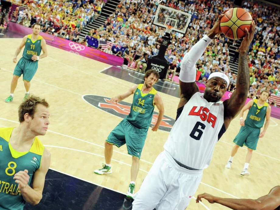 United States' forward LeBron James jumps for the ball during his team's men's quarterfinal basketball game against Australia at the 2012 Summer Olympics on Wednesday, Aug. 8, 2012, in London. (AP Photo/Mark Ralston, Pool) Photo: Mark Ralston, Associated Press / Pool AFP