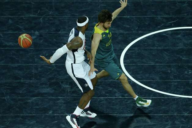 United States' Lebron James, left, passes the ball behind his back in front of Australia's Matt Nielsen, right, during a quarterfinal men's basketball game at the 2012 Summer Olympics, Wednesday, Aug. 8, 2012, in London. (AP Photo/Victor R. Caivano) Photo: Victor R. Caivano, Associated Press / AP
