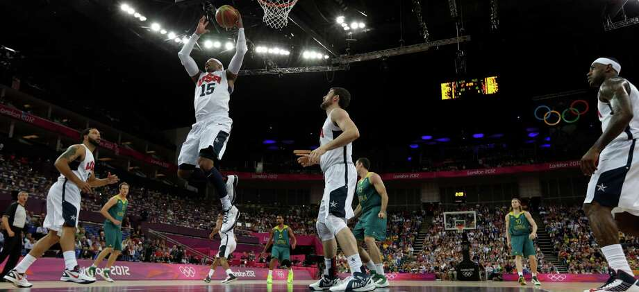 USA's Carmelo Anthony (15) grabs a rebound as teammates Deron Williams, left, and Lebron James, right, look one during a quarterfinal men's basketball game against Australia at the 2012 Summer Olympics, Wednesday, Aug. 8, 2012, in London. (AP Photo/Eric Gay) Photo: Eric Gay, Associated Press / AP