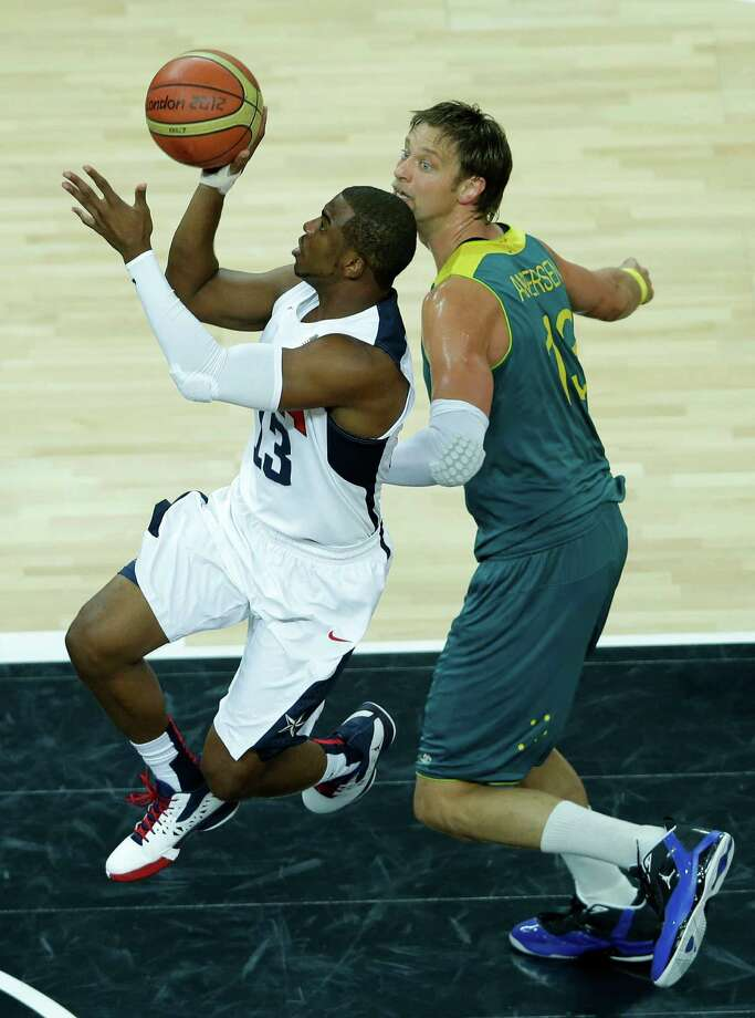 United States' Chris Paul, left, drives past Australia's David Andersen, right, during a quarterfinal men's basketball game at the 2012 Summer Olympics, Wednesday, Aug. 8, 2012, in London. (AP Photo/Victor R. Caivano) Photo: Victor R. Caivano, Associated Press / AP