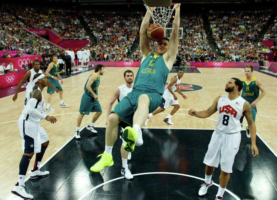 Australia's Aron Baynes, center, dunks against the United States during a men's quarterfinal basketball game at the 2012 Summer Olympics on Wednesday, Aug. 8, 2012, in London. (AP Photo/Sergio Perez, Pool) Photo: Sergio Perez, Associated Press / Pool Reuters