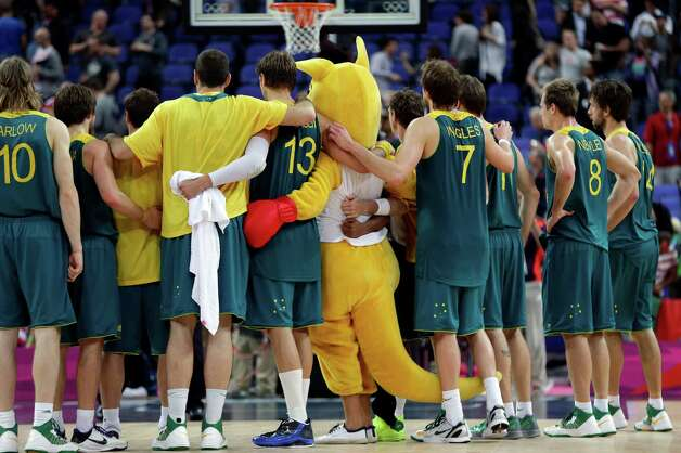 Members of the Australia basketball team pose for a photo following their loss to USA in a quarterfinal men's basketball game at the 2012 Summer Olympics, Wednesday, Aug. 8, 2012, in London. (AP Photo/Eric Gay) Photo: Eric Gay, Associated Press / AP