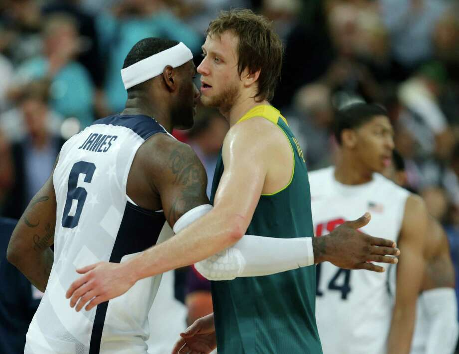 USA's LeBron James embraces Australia's Joe Ingles after their men's quarterfinals basketball game at the 2012 Summer Olympics, Thursday, Aug. 9, 2012, in London. The United States beat Australia, eliminating them from competition. (AP Photo/Charles Krupa) Photo: Charles Krupa, Associated Press / AP