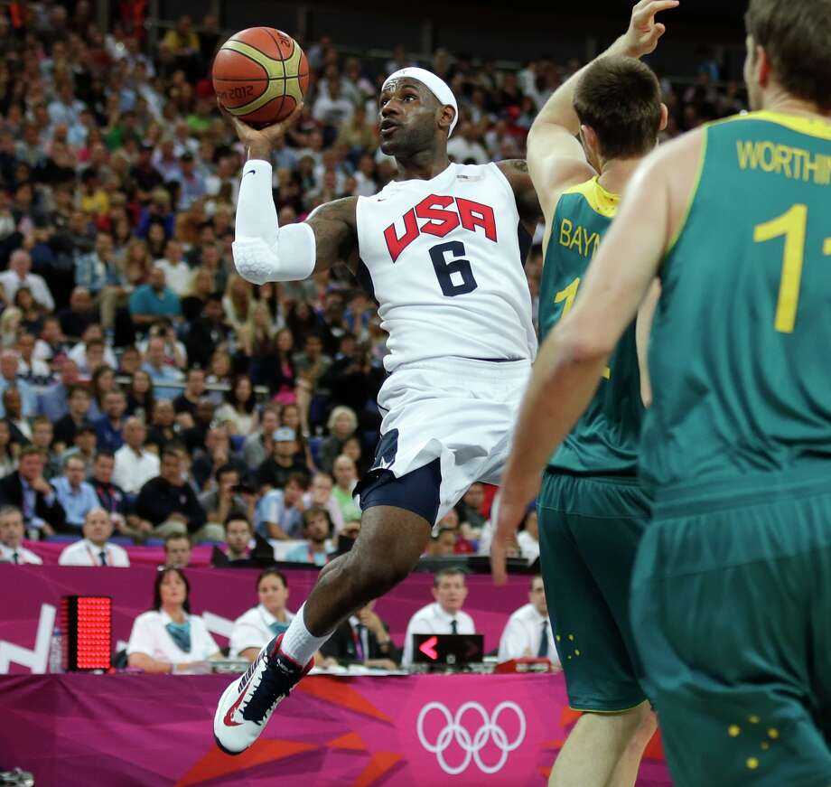 USA's Lebron James drives to the basket against Australia during a men's quarterfinals basketball game at the 2012 Summer Olympics, Wednesday, Aug. 8, 2012, in London. (AP Photo/Charles Krupa) Photo: Charles Krupa, Associated Press / AP