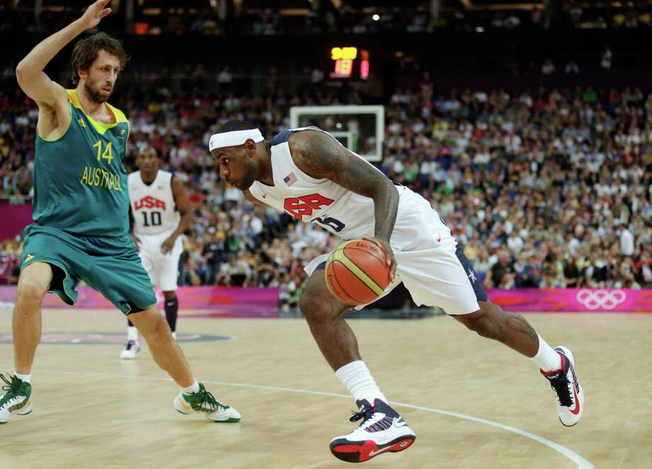 USA's Lebron James, right, drive to the basket against Australia's Matt Nielsen during a men's quarterfinals basketball game at the 2012 Summer Olympics, Wednesday, Aug. 8, 2012, in London. (AP Photo/Charles Krupa) Photo: Charles Krupa, Associated Press / AP